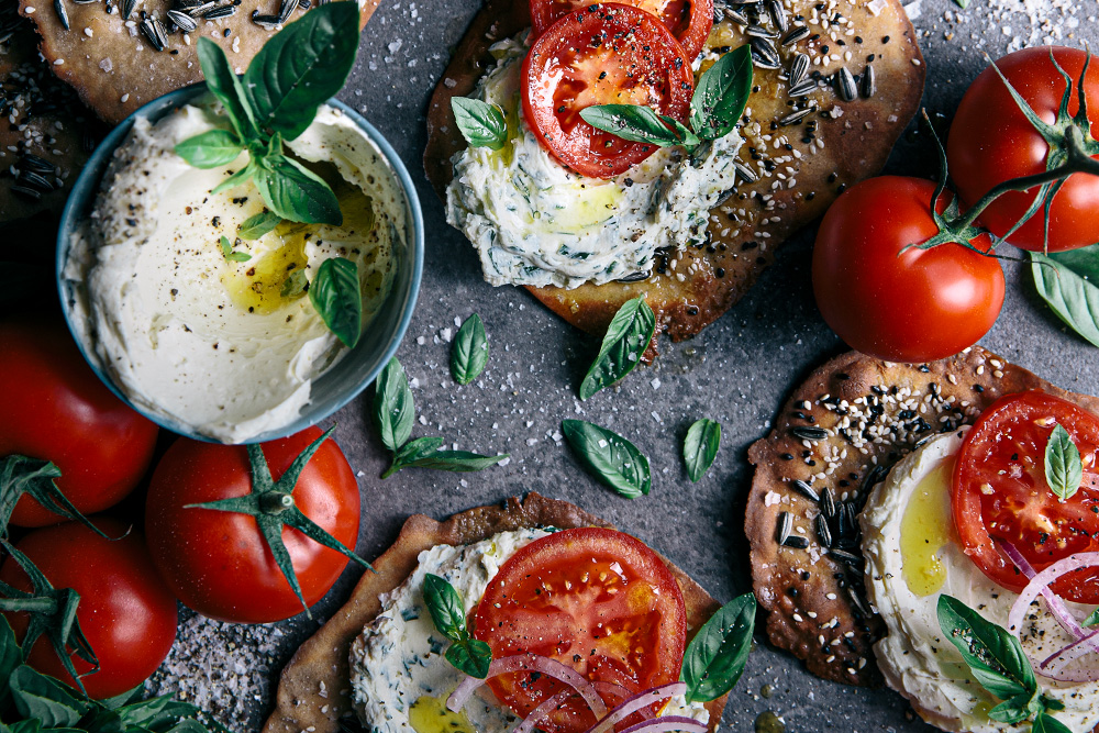 Seedy Buckwheat Flatbreads with Herby Philly Cream Cheese & Fresh Tomato  |  Gather & Feast