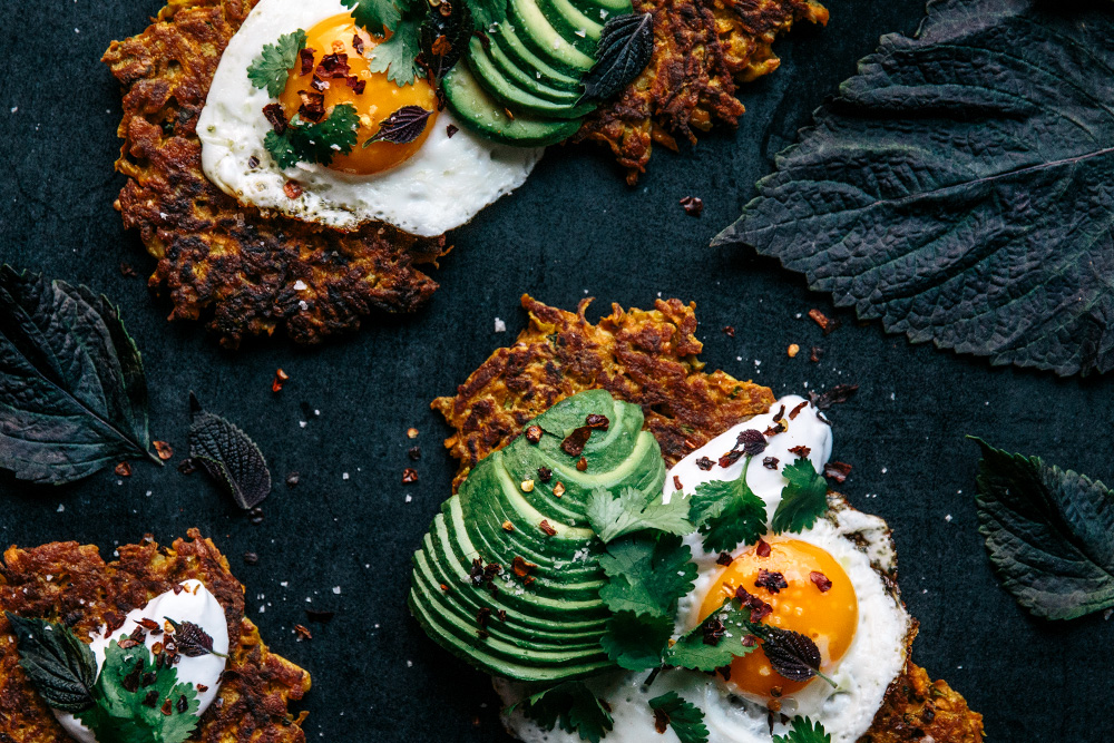 Turmeric Spiced Carrot & Halloumi Fritters with Coriander, Fried Eggs & Avocado  |  Gather & Feast